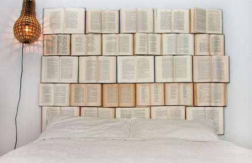 Headboard made of books! This would be perfect for my brother!