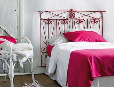 Headboard made from old wrought iron and sprayed red