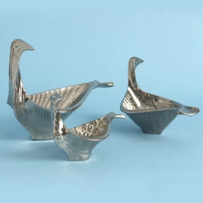 "My love of Jonathan Adler started with his pottery. These bird bowls are my favorite and actually an ""affordable"" Christmas present. Hint hint, nudge nudge, Steve."
